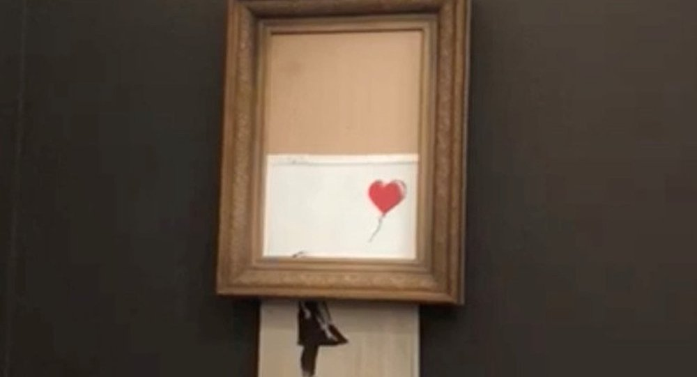 Banksy'nin 'Balonlu Kız' adlı eseri kendini parçalara ayırmasına rağmen satıldı